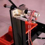На фото: опциональное приспособление для [цилиндрической] печати на ремешках, лентах, шнурках.